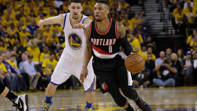 Portland Trail Blazers' Damian Lillard (0) dribbles past Golden State Warriors' Klay Thompson (11) during the first half in Game 2 of a second-round NBA basketball playoff series Tuesday, May 3, 2016, in Oakland, Calif. (AP Photo/Marcio Jose Sanchez)