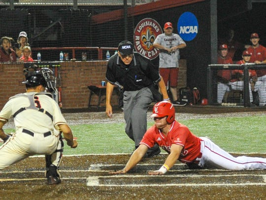 Joe Robbins slides into home as UL beats Princeton in the first round of the NCAA Regional Tournament at Tigue Moore Field.