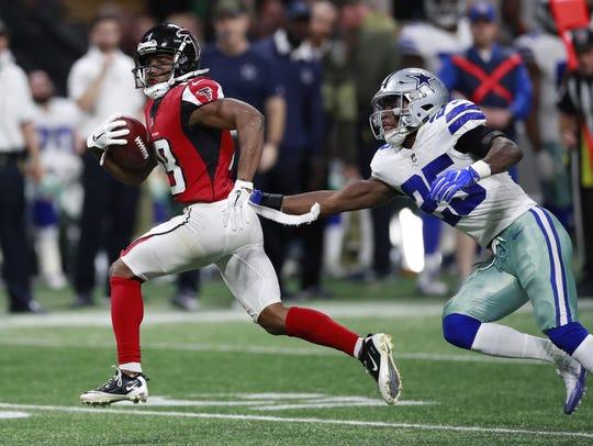 Atlanta Falcons wide receiver Taylor Gabriel (18) runs