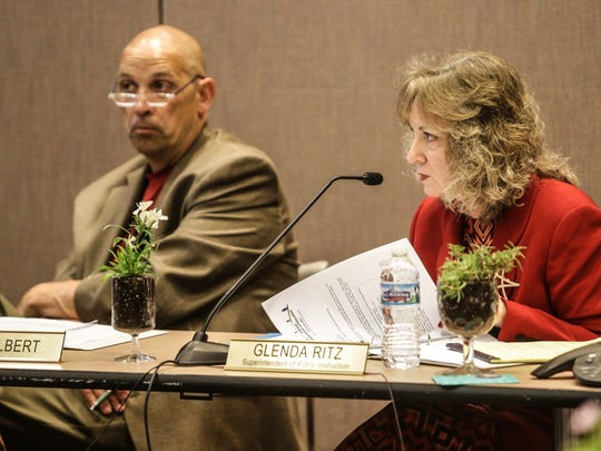 Indiana State Board of Education members Superintendent Glenda Ritz (right) and Troy Albert