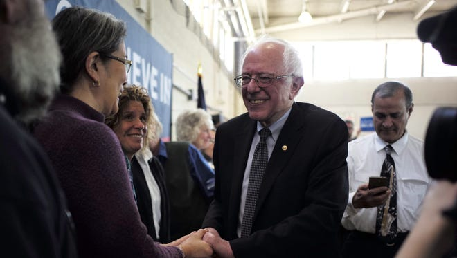 Sen. Bernie Sanders is greeted at a campaign stop in Peterborough, NH.