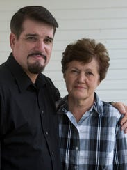 Brent Cosby poses with his mother Judith Cosby in Rutledge,