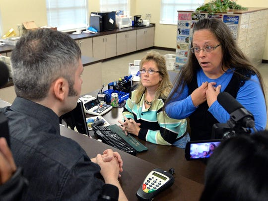 Rowan County Clerk Kim Davis, right, talks with David Moore following her office's refusal to issue marriage licenses at the Rowan County Courthouse in Morehead, Ky.