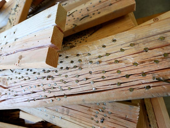 Practice boards are filled with nails at the recently