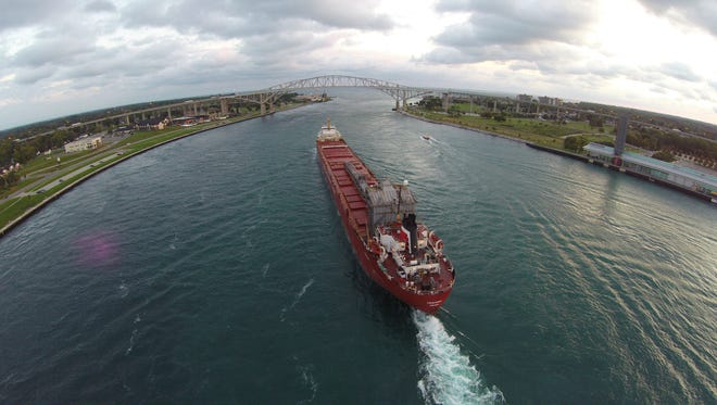 A freighter owned by the Interlake Steamship Co carries a load of coal along the St. Clair River. Monroe, a Great Lakes gateway port on Lake Erie, is  slated for state-funded improvements.