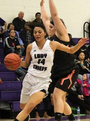 Mescalero's Lauryn Yuzos, left, tries to dribble past