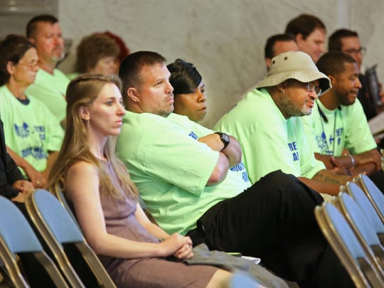 Members of the Amalgamated Transit Union (green shirts) listen to streetcar discussion on Wednesday.