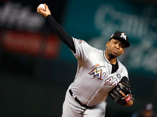 Miami Marlins starting pitcher Odrisamer Despaigne delivers a pitch to Colorado Rockies' Charlie Blackmon during the first inning of a baseball game Monday, Sept. 25, 2017, in Denver. (AP Photo/David Zalubowski)