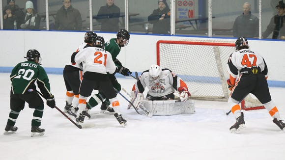 Mamaroneck goalie Jack Fried (35) makes a save during