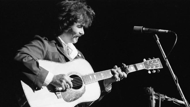 John Prine, preceding Bonnie Raitt, performs at the Grand Ole Opry House Oct. 29, 1975.