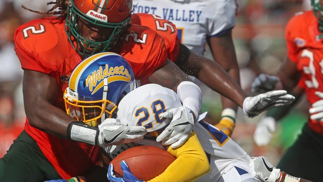 FAMU's Jabreel Hazly tackles Fort Valley State University's O'Brian Anderson as they open the season at Bragg Memorial Stadium on Saturday, Sept. 1, 2018.