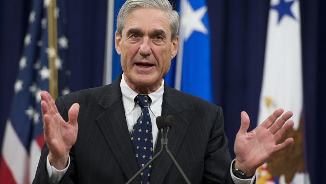 Robert Mueller, speaking at a farewell event in his honor, left the Department of Justice on Aug. 1, 2013, after directing the FBI in the Bush and Obama administrations.