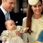 Prince William and Duchess Kate of Cambridge hold baby Prince George at his christening, when he was 3 months old. They're taking him with them on a tour Down Under in April.