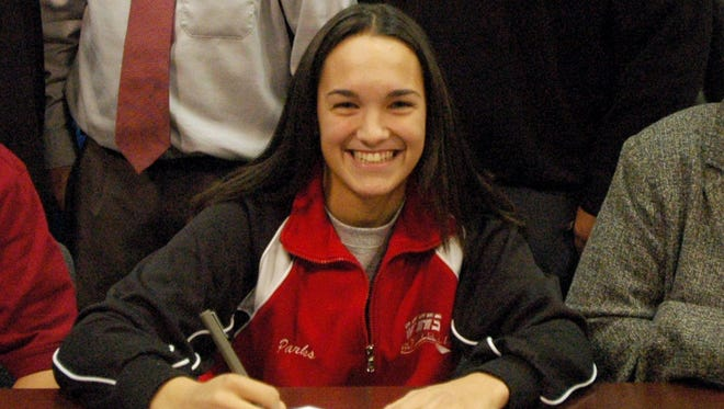 Vineland native Dana Parks sign her National Letter of Intent to St. Joseph's University in 2008. On Friday, she was hired by the Philadelphia Phillies to work in player development.