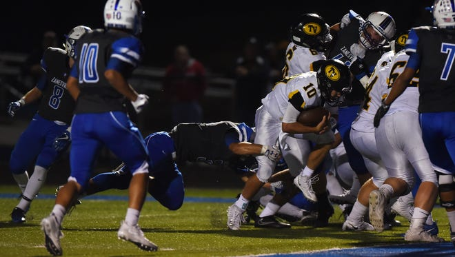 Tri-Valley's Andrew Newsom heads to the end zone against Zanesville.
