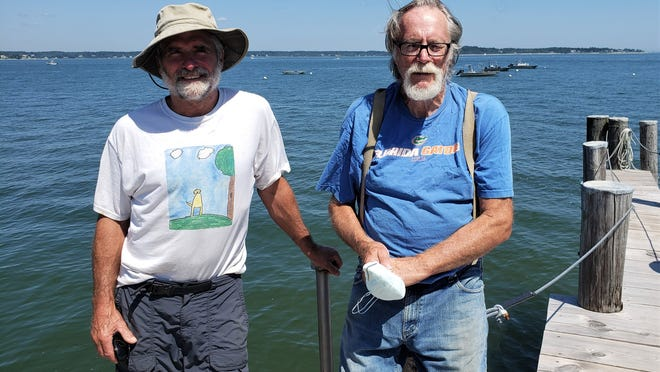 Sean Withington and Don Wilkinson donated the use of the oyster boats to deliver new gangways for the Mayflower II.