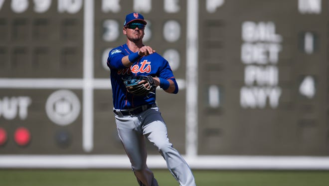 Matt Reynolds, an infielder for the New York Mets, throws out a member of the Red Sox during a spring training game at JetBlue Park in Fort Myers on Friday.