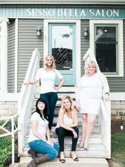 In a world of transitory employees, the Sesso Bella team have been there 13 years, eight years, and four years respectively. From left are Emma Endejan, Danielle Riggs, Sarah Sippel and Kim Wahl-Ruppenthal. Wahl-Ruppenthal is the owner of the downtown Fond du Lac salon.