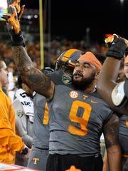 Tennessee defensive end Derek Barnett waves to fans