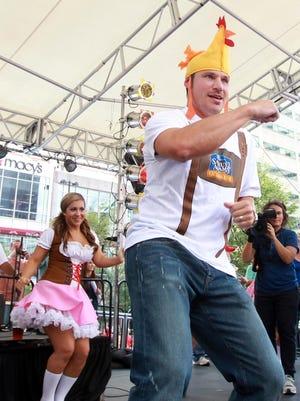 """Nick Lachey leads the """"Chicken Dance"""" at Oktoberfest Zinzinnati in 2014."""