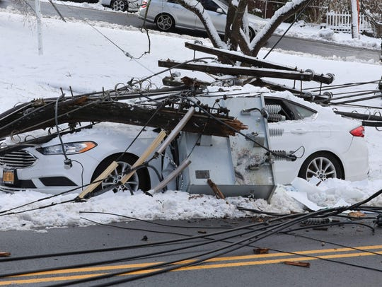 Utility poles, pictured March 8, 2018, fell like dominoes