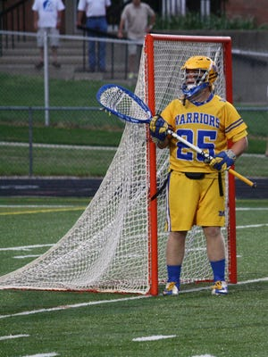 Mariemont goalie Sam Long mans the cage during the Warriors' 16-9 win over Columbus St. Francis DeSales in the 2013 Division II state semifinals at Wilmington College.
