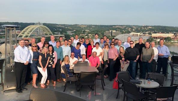 P.L. Marketing's leadership team gathers at the company's