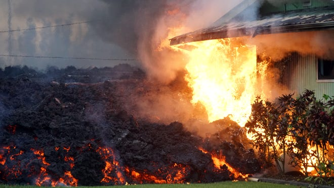 Flames started by lava consume a house in the Leilani Estates neighborhood on May 6, 2018 near Pahoa, Hawaii.