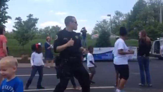 An MCSO deputy dances with the crowd at the FUEL Block Party