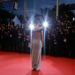 "Marion Cotillard poses for photographers as she leaves the screening of ""The Little Prince"" at the Cannes Film Festival on May 22."