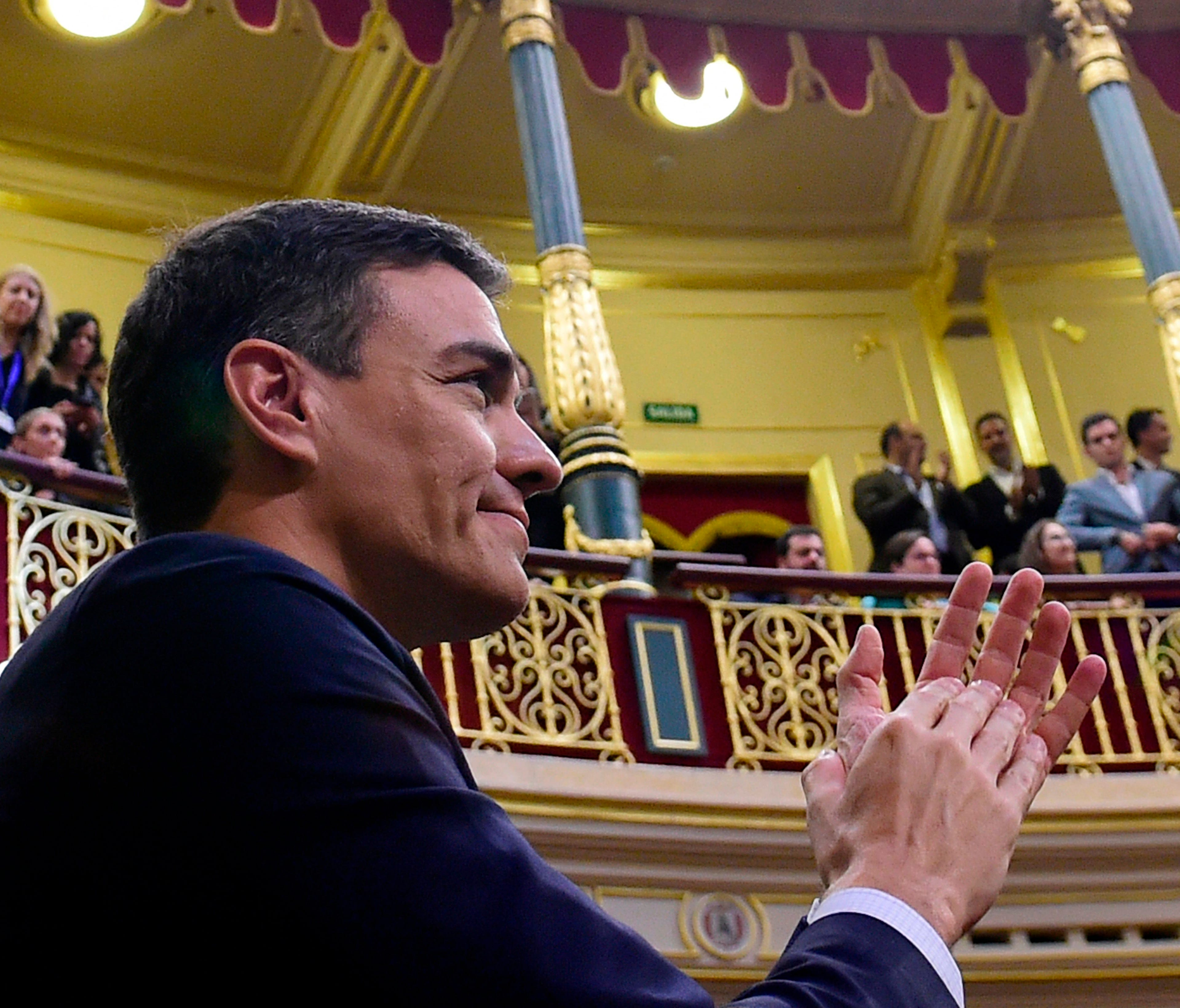 Spain's new Prime Minister Pedro Sanchez acknowledges applause after a vote on a no-confidence motion at the Lower House of the Spanish Parliament in Madrid on June 1, 2018.