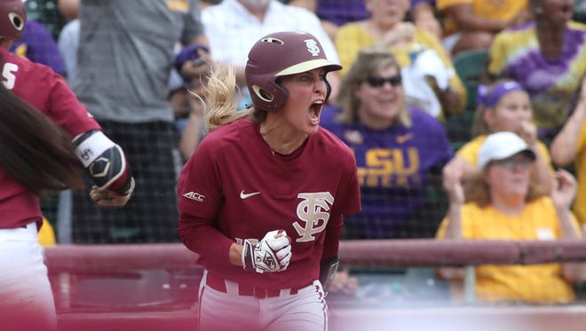 FSU's Carsyn Gordon celebrates after sliding in safely for a run against LSU during the second game of their NCAA Super Regional series at JoAnne Graf Field on Saturday, May 26, 2018.