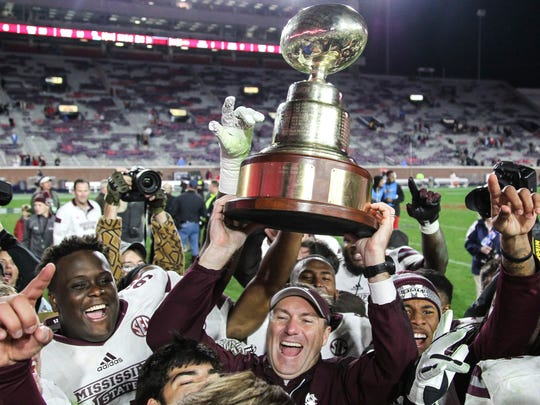 Mississippi State coach Dan Mullen celebrates winning the 2016 Egg Bowl.