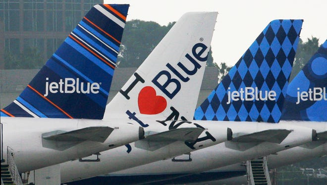 JetBlue's planes, like these in Long Beach, Calif., each feature distinctive tail art.