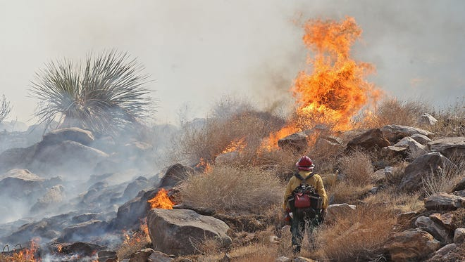 A firefighter pauses while working the brush fire near the Palm Springs Aerial Tramway, Tuesday, August 6th, 2013.  Jay Calderon/The Desert Sun