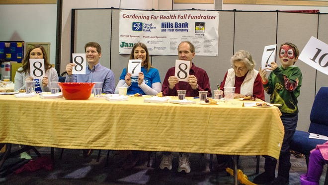 Judges rate a pie as part of the bake-off during the Gardening for Health event at the First United Methodist Church in North Liberty on Sunday, November 23, 2014. Proceeds from the event benefitted the North Liberty Food Pantry.