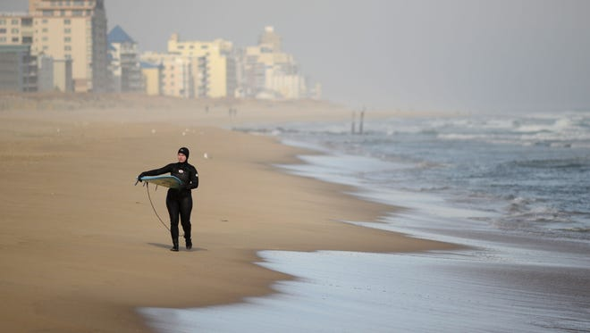 Sarah Schwind walks down the beach near 42nd Street in Ocean City after spending some time in the frigid Atlantic.