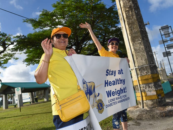 Lions Clubs International members Annie Payne, left,