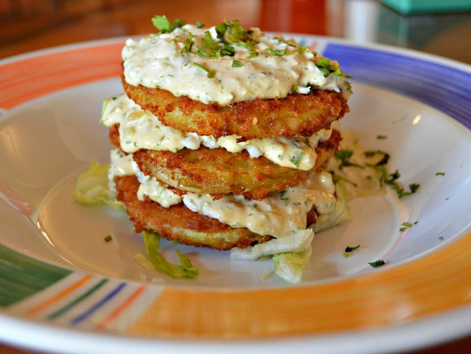 Fried green tomatoes, served with creamy crab remoulade,