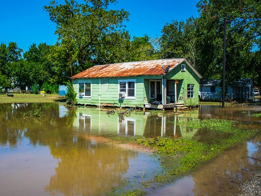 Old Weathered and Destroyed Home in Flood Water Disaster in La Grange, Texas