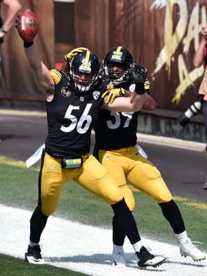 Pittsburgh Steelers outside linebacker Anthony Chickillo (56) and running back Terrell Watson celebrate after Chickillo scored a touchdown during the first half of an NFL football game against the Cleveland Browns, Sunday, Sept. 10, 2017, in Cleveland.