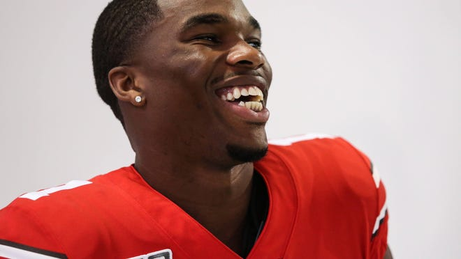 Ohio State cornerback, Jeff Okudah, laughs in between portraits at the Woody Hayes Athletic Center in Columbus, Ohio.