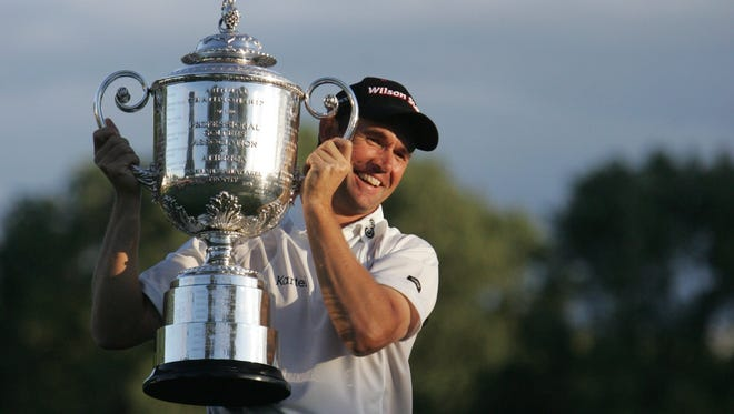 Padraig Harrington holds the Wanamaker Trophy after winning the 90th PGA Championship at Oakland Hills Country Club in Bloombield Twp., Sunday, August 10, 2008. KIRTHMON F DOZIER/Detroit Free Press