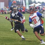 Northville's Nate Holoway (right) helped the U-17 Mavericks to a 22-1 summer lacrosse record.