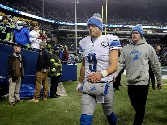 Lions quarterback Matthew Stafford walks off the field