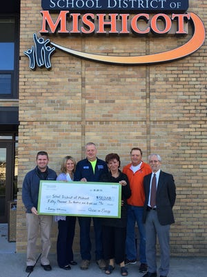 On Oct. 25, School District of Mishicot received a check for $50,208 from Focus on Energy for energy-efficient initiatives made possible by the $10 million renovation project recently completed at the school district. Pictured from left: Joe Kottwitz, energy adviser, Focus on Energy; Christine Thelen, business manager; John Taddy, building and grounds/transportation supervisor; Judy Ferry and Robert Shimek, school board members; and Dr. Lee Bush, interim superintendent.
