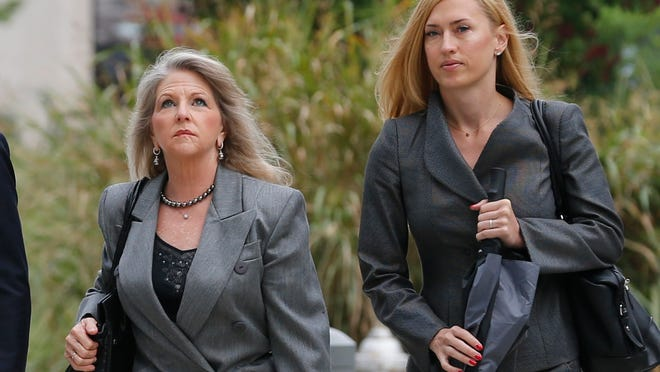 Former Virginia first lady Maureen McDonnell walks to federal court with her attorney Heather Martin, in Richmond, Va., Monday, Aug. 18, 2014. The McDonnells present their defense today. (AP Photo/Steve Helber)