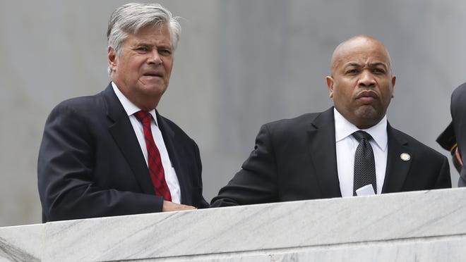 Senate Majority Leader Dean Skelos, R-Rockville Centre, left, stands with Assembly Speaker Carl Heastie, D-Bronx, before a ceremony at the New York State Police Officers Memorial on Tuesday, May 5, 2015, in Albany, N.Y. Skelos is holding on to power following federal corruption charges even as some fellow Republicans say he should step down as leader to avoid a political distraction. Skelos was arrested Monday on charges that he traded his influence for payments from a real estate firm and environmental technology company that went to his son, Adam Skelos, who is also charged in the case. (AP Photo/Mike Groll)