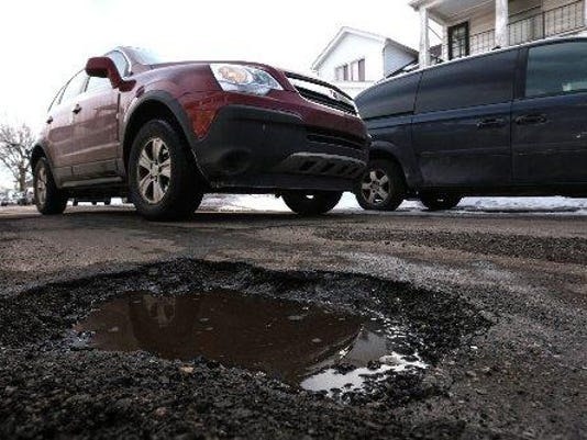 Group seeks to fix roads by raising taxes on businesses