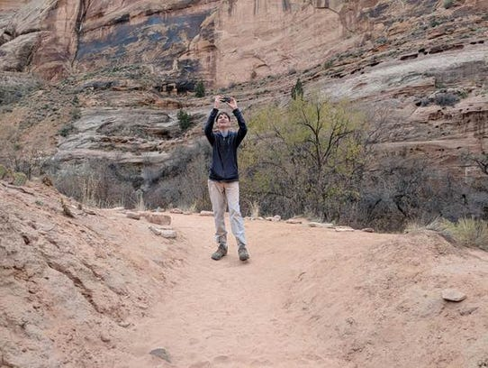 Aren Elliott takes a picture of the rocks in Sedona,